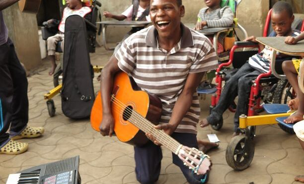TUL DONATES BOOKS INCLUDING MUSIC INSTRUMENTS TO A LEARNING CENTRE FOR THE DISABLED